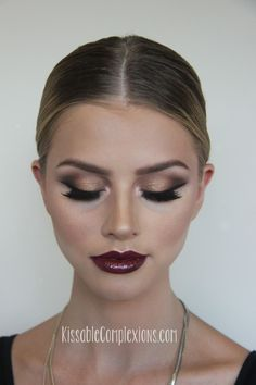 {kissable complexions} Dramatic and glamorous makeup with winged liner, golden shimmer, and bordeaux lips <3