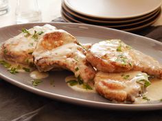 Smothered Pork Chops recipe from Tyler Florence via Food Network