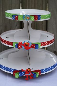 @http://www.etsy.com/listing/70309222/elmo-cupcake-tower?ref=sr_gallery_28_search_submit=_search_query=elmo+party_page=2_search_type=handmade_facet=handmade  i can make this!!!!!