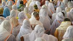 Indian widows from Vrindavan, the northern state of Uttar Pradesh, listen to speakers during a function in Delhi on September 27, 2012
