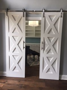I know that barn doors have been around for awhile now, but I STILL believe they are worth all the hype. Since Joanna & Chip put them on the map in home design, they continue to show up in tons… Inside Barn Doors, Double Barn Doors, Garage Door Design, Garage Doors, Sliding Doors, Basement Doors, Making Barn Doors, Barn Door Closet, Laundry Room Doors