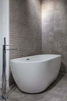 Freestanding tubs are often deeper than the jacuzzi tubs of the 1980s, and many come with the option of spa jets. These new designs also take up less space than the older varieties, which were tiled into the bathroom ~ http://walkinshowers.org/best-free-standing-tub-reviews.html