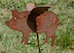 Flying Pig Garden Yard Art on Etsy, $12.95
