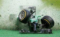 Catherham driver Kamui Kobayashi crashes in the first corner of the Melbourne GP