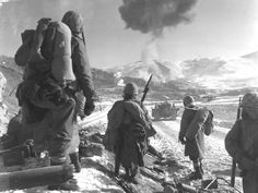 US Marine Corps F4U Corsairs drop napalm on Chinese   positions of Battle of Chosin Reservoir