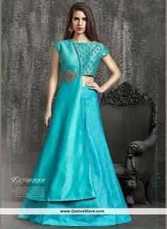 Thrilling Turquoise Raw Silk Lehenga Choli