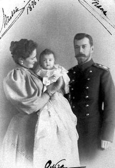 "Tsar Nicholas ll of Russia and Empress Alexandra Feodorovna of Russia with their first born,the Grand Duchess Olga Nikolaevna Romanova of Russia in 1896. ""AL"""