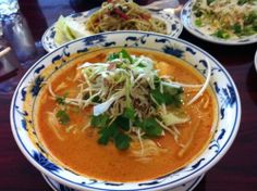 Khao poon - ເຂົ້າປຸ້ນ  Made from spicy Lao rice vermicelli soup. The coconut milk broth is simmered for a long time with pounded chicken, fish, or pork. It is served with many vegetables, such as shredded cabbage, bean sprouts, cilantro, and lime.  My favorite part of the dish are the chicken bones because the tender meat just falls off. Okay…now I really want some. I miss my mom's home cooking!