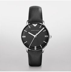 Classic   						  			  				$245.00  This watch features a stainless steel case with a black dial. A smooth leather strap finishes the look.
