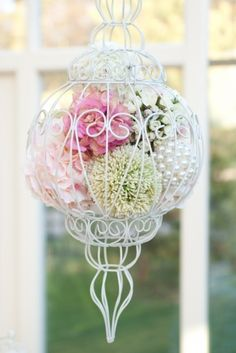 Hanging flower arrangement from Big Little Things. #wedding #chairdecor #flowers