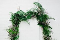 Ceremony arch heavy with foliage