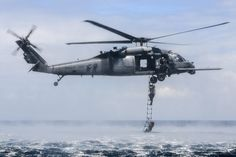 HH-60G Pave Hawk performing rope ladder recovery off the coast of Okinawa Japan [2048x1365]
