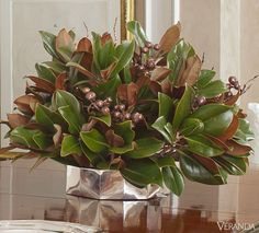 15 Winter Floral Arrangements For Grand Seasonal Decor - 12 Winter Floral Arrangements – Magnolia Leaves with Gilded Berries Best Picture For country gar - Winter Flower Arrangements, Christmas Arrangements, Christmas Centerpieces, Floral Centerpieces, Xmas Decorations, Floral Arrangements, Christmas Tables, Magnolia Centerpiece, Garden Types
