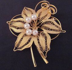 Budding beauty is the only way to describe this floral foliage brooch.
