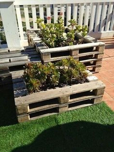 using old palettes to create new planters is an effective way to landscape outside space.