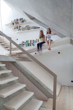 This Berlin townhouse by architecture office XTH-Berlin features doors that open like drawbridges, sloping floors that function as slides and nets that cover holes in the floors