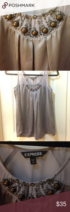 Top/blouse with minimal wear. Sleeveless grey satin top with sheer shoulder panel on front and back, with sequins on front. Can be worn formally with a blazer, or casually with jeans. No signs of wear, worn twice. Express Tops Blouses