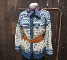 Vintage Dale of Norway wool sweater, in a Fair Isle pattern in ivory, and shades of blue. This lovely cardigan is knitted of quality 100% new wool
