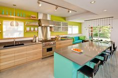 Communal kitchen all open with a couch! I also love the lime and sea foam green!