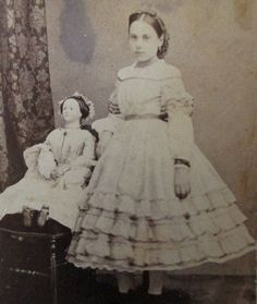 CDV of a Parisian girl with a large doll