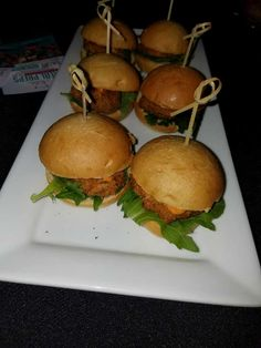 Crab cake sliders with arugula and homemade remoulade sauce