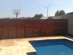 Merbau Screen #morningtonpeninsula #poolscreen Planter Boxes, Planters, Merbau Decking, Wood Edging, Landscape Design, Coastal, Pergola, Construction, Fences