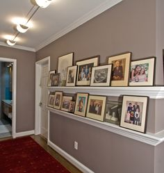 I often suggest that my clients use picture ledged in their homes. Many stores now sell ledges that are 2 feet to 4 feet in length. You can buy ones that are modern or traditional. I usually prefer to build picture ledges into the molding scheme of the homes, like the ledges above. You can fit more pictures and they feel better integrated with the architecture.
