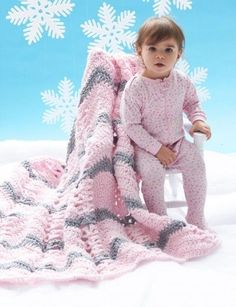 Chunky and Cozy Baby Blanket - The bulky yarn used for this baby crochet blanket will keep baby warm all winter long. She'll love the design, but more so the comfort.