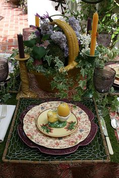 Easter setting...love the wire place mat, pretty plates and egg holder