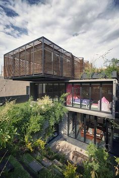 Fascinating three-story stacked house from Mexico City, designed Architect Yuri Zagorin Alazraki. This exciting architectural highlight comes with a open concept layout, rooftop garden and creative design features to bring natural light into the living areas.