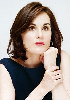 Michelle Dockery attends the photocall for the fifth season of Downton Abbey in Beverly Hills (23 July 2014)