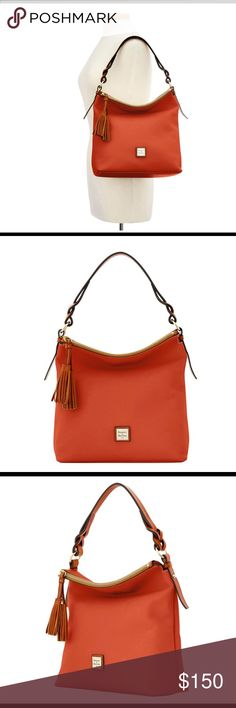 "Dooney and Bourke Pebble Grain Small Sloan Bag NWT. Still in original packaging. One inside zip pocket. Two inside pockets. Cell phone pocket. Inside Key hook. Handle drop length is 12"". Lined and zipper closure. Color is Burnt Orange. Measurements are 11.5""(H)x5""(W)X11.75""(L). Dooney & Bourke Bags Shoulder Bags"