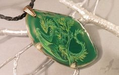 Dragon of the greenery It's miniature handmade painting on the stone, it's very small in person!Stone size: 5.8x3.3 cm (2.54cm=1inch) Agate stone, metallic furniture, black cord.100% handmade paint...