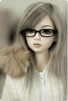 Delicate features - Beautiful doll . . . the glasses add a unique touch!