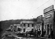 A downtown Portland street from just a few years after the town was founded, in 1851. Note the stump in the foreground. (Image: Oregon State University Archives)