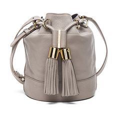 Tassel crossbody bag by See By Chloe. Grained leather with canvas fabric lining and gold-tone hardware.  Made in India.  Measures appro...