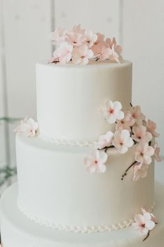 A beautiful cherry blossom 2-tier wedding cake.