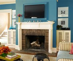 TV over fireplace,storage on sides, low chaise for keeping room open, seating, and an extra bed for sleeping