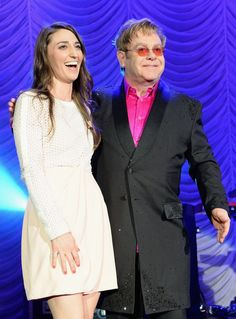Goodbye yellow brick road, hello hot pink philanthropy. Recent GRAMMY nominee Sara Bareilles and GRAMMY winner Elton John are happy in pink at the Breast Cancer Research Foundation's 2014 Hot Pink Party on April 28 in New York