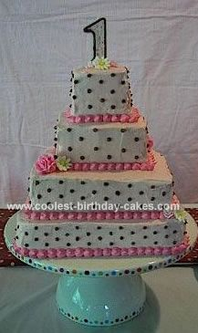 Pink and Brown Polka Dot Cake: For my little girl's first birthday, I wanted a pink and brown polka dot cake.  I love tiered cakes, so make a layered cake using basic square pans and