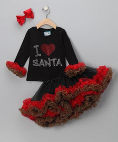 Adorned with ruffles and ablaze with sparkling rhinestones, this fluffy ensemble is sure to inspire smiles wherever it goes. And with the easy-on elastic waistband and ouchless alligator clip on the bow, this set is as fancy-free as it is festive.               Includes tutu, top and bow clip                 Polyester / cotton