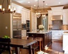 Check out this color scheme:  bellingham countertops, wood island and white perimeter cabinets, khaki painted walls