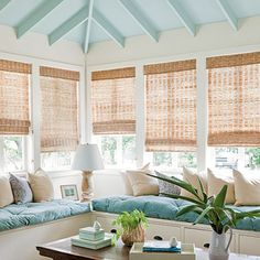 Sea and sand tones...High pale aqua timber ceilings and bamboo blinds...light and airy beach house corner with pale aqua cushioned window seats...