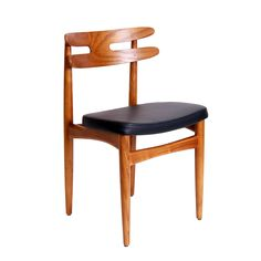 Inspired by a 1956 design, this mid-century modern chair is extremely comfortable. The wide back design coupled with the padded seat allows the chair to support the body. Made of ash wood with a padded polyurethane seat, the chair works as a statement on style and comfort in your living or dining room. Corner Chair | dotandbo.com
