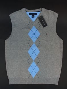 Get fashionable warm during colder days with a sweater vest! Get helpful fashion tips in wearing sweater vests right here! Sweater Vests, Cotton Sweater, Wool Sweaters, Swim Wear, Street Fashion, Sneakers Fashion, Tommy Hilfiger, Menswear, Street Style