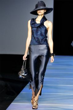 Milan Fashion Week '12 Giorgio Armani. Slate Blue pants with slits, lovely. If i could collect one fashion item it would be hats.