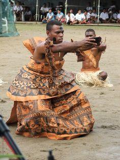 Fijian Man in full bark cloth (masi) presenting the bilo ni yaqona (cup of kava)