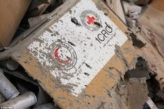 Ash covers cardboard packages carrying International Red ☪Crescent/Cross⊕ insignia on convoy delivering aid to besieged civilians in Aleppo province was consumed by flames