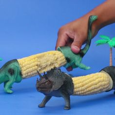 Dino Corn On The Cob Holders. Actually, that is really clever, and gives me ideas about things. I have to say, I felt bad for the poor dinosaur when they put him in a vise grip to cut him in half. ;-p I guess one could call it 'plastic surgery.' HA!!!!