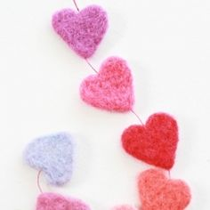 Make a needle felted heart garland using cookie cutters as a template.